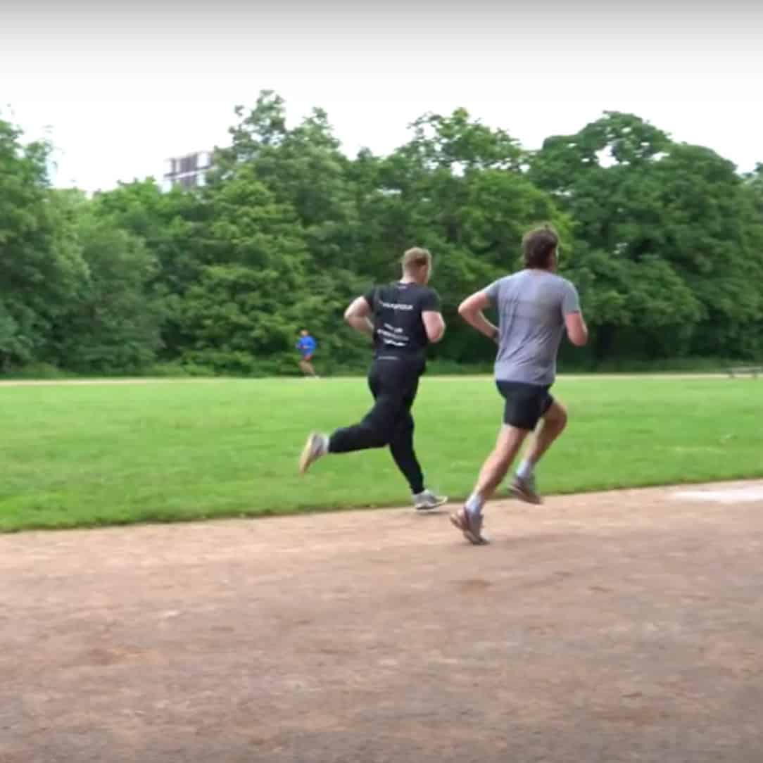 Mobile personal trainer running with a client