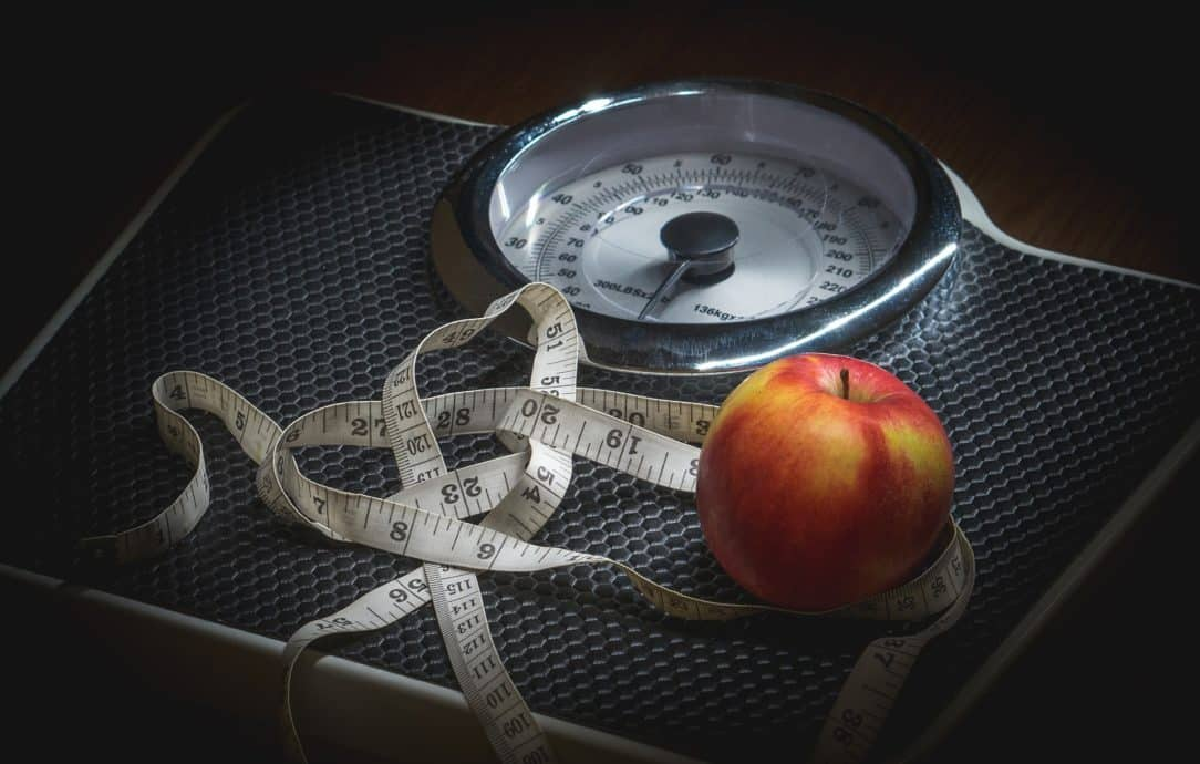 Find ways to stay motivated by setting goals - weighing scales and tape measure used to measure progress