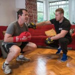 Mobile personal trainer working out with a client.